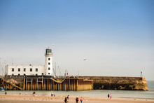 St. Vincent Pier And The Historic Lighthouse At Scarborough, North Yorkshire, UK.