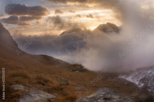 Poster Marron chocolat Great view of the foggy valley in Gran Paradiso National Park, Alps, Italy, dramatic scene, beautiful world. colourful autumn morning,scenic view with cloudy sky, majestic dawn in mountain landscape