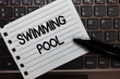 Text sign showing Swimming Pool. Conceptual photo Structure designed to hold water for leisure activities Notebook piece paper keyboard Inspiration ideas Type computer black marker