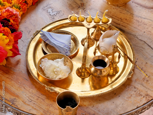 Puja tray and accessories for worship in the Hare Krishna temple.