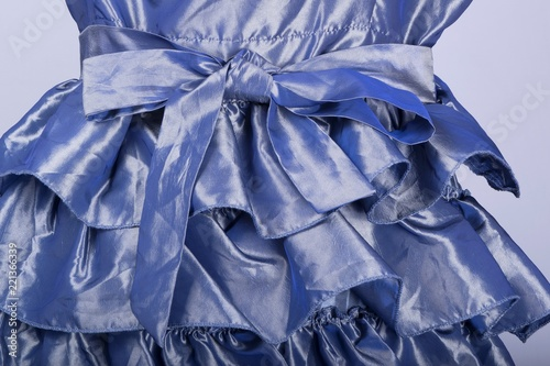Tuinposter Abstract bloemen Tailors Mannequin dressed in a Blue Satin Dress