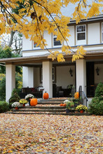 Seasonal House Outdoor Decoration. Main Entrance Stair And Porch Of The Stylish House Decorated For Autumn Holidays Season, Branches Of The Yellow Colored Tree And Foliage On A Foreground.