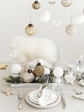 Golden And Silver Baubles In Design Of Table Setting.