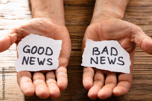 Fotografie, Obraz  Man Showing Paper With Good And Bad News