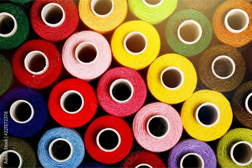 Spools of colorful thread, different colors background Fototapet