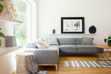 Black And White Textiles And Decorations In A Classic Scandinavian Style Living Room Interior With Wooden Furniture And Natural Sunlight