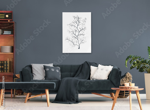 Wooden Table And Bench In Front Of Sofa With Pillows In Dark Flat Interior With Poster And Plant Real Photo Buy This Stock Photo And Explore Similar Images At Adobe Stock