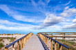 canvas print picture - Wooden walkway to the sea at costa nova in Portugal