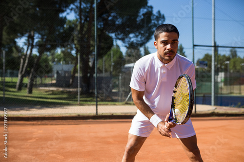 Man playing tennis