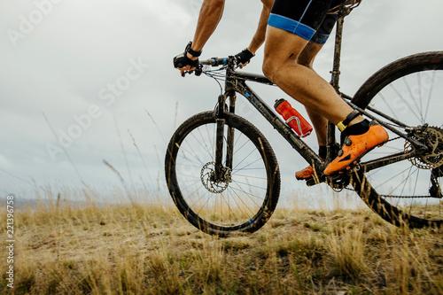 athlete cyclist in mountain bike riding on mountain trail