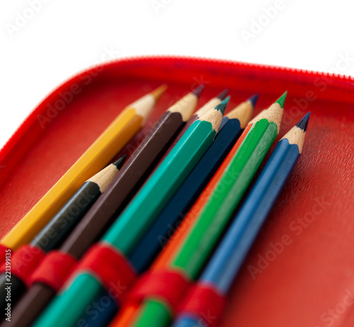 Stampa su Tela Pencil case with colorful pencils close-up on white background