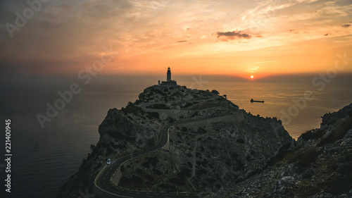 Garden Poster Lighthouse Very photographed place and tourist attraction is Cap de Formentor lighthouse on the north eastern tip of the Serra de Tramuntan mountain range in Majorca at sunrise. Romantic morning at sea.
