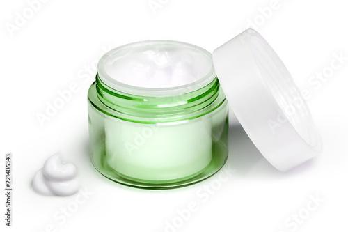 Slika na platnu Container of moisturizing face cream on white background