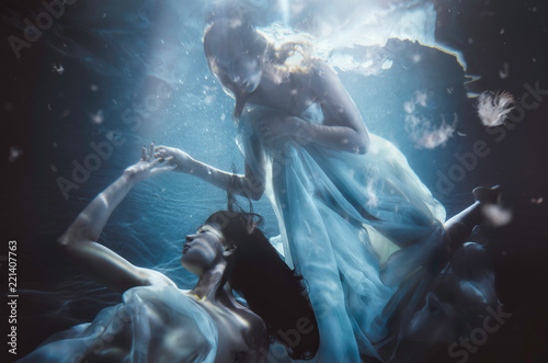 Tablou Canvas Beautiful woman swimming with fancy dress underwater