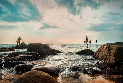 SRI LANKA, Traditional Sri Lanka sea fishermen, Tropical beach under blue sky in sunny day
