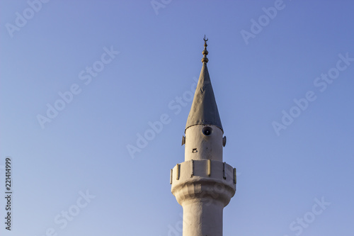 Clear shoot of old masonry minaret with blue sky background Fototapeta