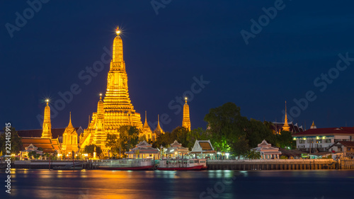 The iconic Temple of Dawn, Wat Arun, along the Chao Phraya river on twilight, Bangkok, Thailand