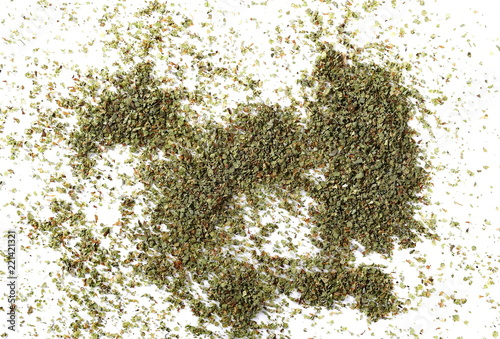 Keuken foto achterwand Kruiderij Dry marjoram pile isolated on white background, top view