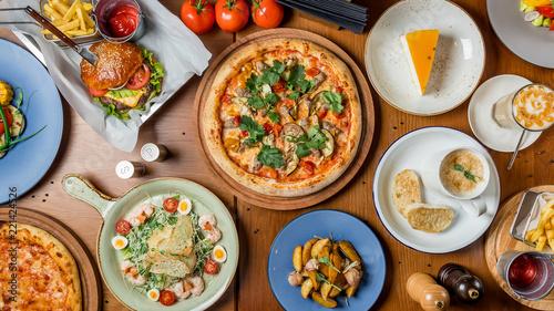 Food set of european cuisine, pizza, Burger, salad caesar, potatoes and cream soup top view © bbivirys