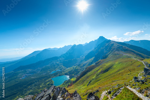 The bright sun in the sky over the top of Kasprowy Wierch, Poland