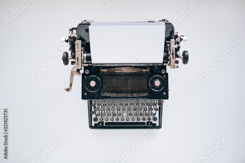 Obraz Retro typewriter on white table - fototapety do salonu
