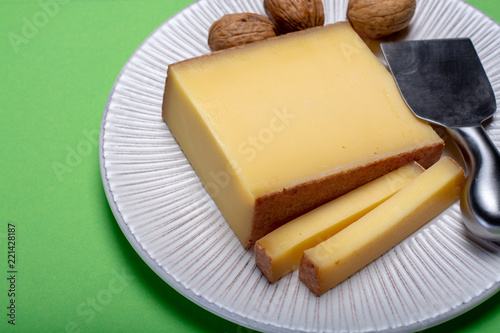 Piece of aged Comte or Gruyere de Comte, AOC French cheese made from unpasteurized cow's milk in the Franche-Comte region of eastern France with traditional methods of production.