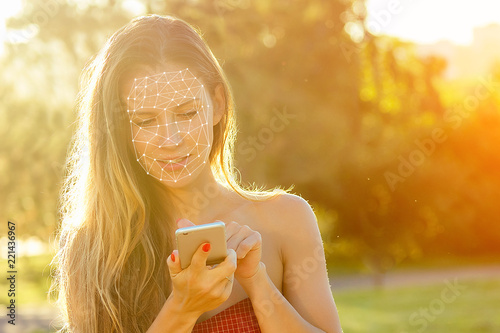 Photo  model woman long-haired in red dress holds phone and talking typing text with boyfriends in hand rays of sun background
