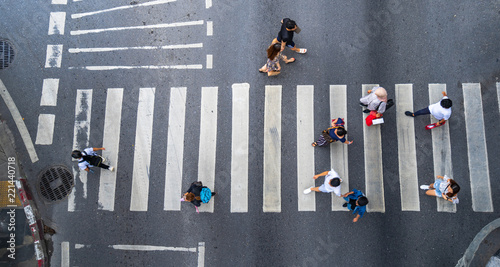 Stampa su Tela Aerial photo top view of people walk on street in the city over pedestrian cross