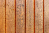 Brown painted old wooden planks texture with scratches. Abstract wooden background