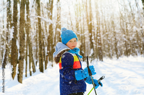 young boy ski in winter nature