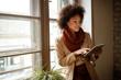Leinwandbild Motiv Woman on workplace taking information from iPod