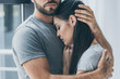 canvas print picture - cropped shot of bearded man hugging and supporting young sad woman