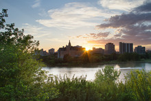 A Summer Evening Along The South Saskatoon River Looking To The West And The Colorful Sunset Over The City.