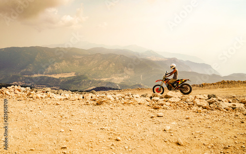 Papiers peints Nautique motorise Fethiye, Mugla/Turkey- August 19 2018: Mountain motor biker riding on dusty road on Babadag