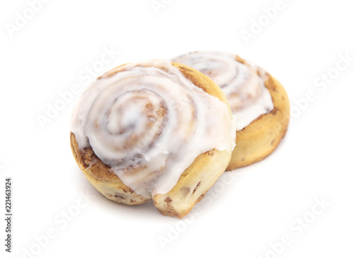 Two Frosted Cinnamon Rolls on a White Background Fototapete