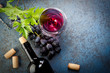Red wine and fresh grapes