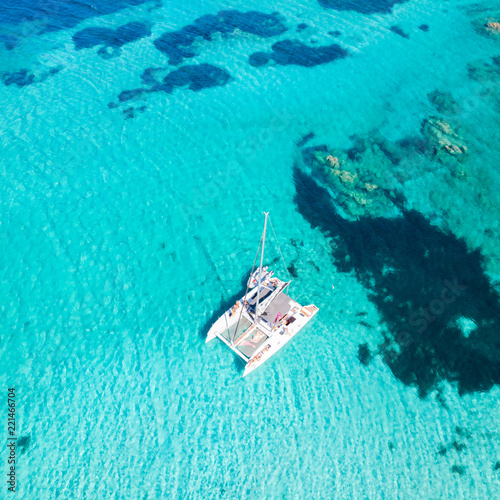 Tablou Canvas Drone aerial view of catamaran sailing boat in Maddalena Archipelago, Sardinia, Italy
