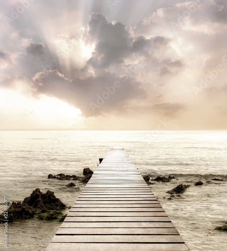 Motiv-Rollo Basic - Wood bridge on the sea which has walk way for travel with beautiful sky and sunshine background. (von nicemyphoto)