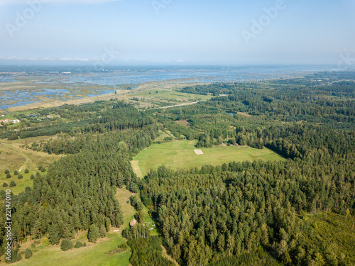 In de dag Pistache drone image. aerial view of rural area with fields and forests. textured background