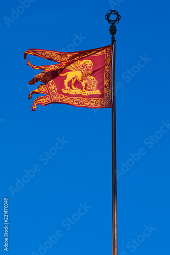 Venice republic Serenissima flag in the wind, clear blue sky in a sunny day
