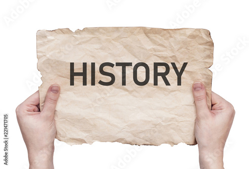 "Foto  word ""History"" written on old sheet"
