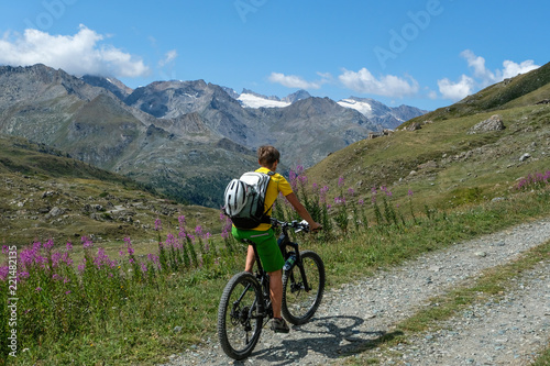 Deurstickers Fietsen mountainbiker in action in the beautiful aosta valley, Italy, Europe