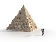 Man Builds A Pyramid Of Cubes