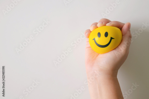 Fotografie, Obraz  Hand squeeze yellow stress ball.
