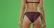 Close-up of a millennial black woman's butt in swimsuit on green screen