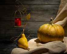 Still Life Of Autumn Pumpkins Of Various Sizes. On A Wooden Background. With Candlestick For Halloween