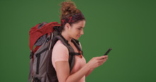 Woman Hiker Using Smartphone To Lookup On Green Screen