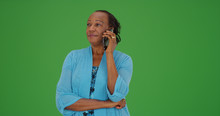Senior Black Woman Making Phone Call On Green Screen