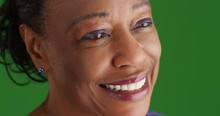 Close-up Of Smiling Mature Black Woman On Green Screen