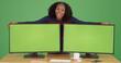 Leinwanddruck Bild - Black woman posing with computers with green screen displays on green screen